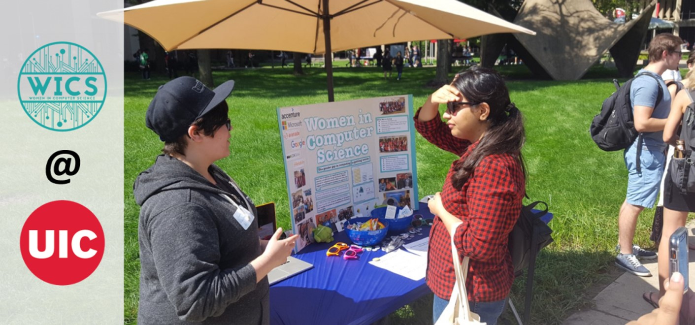 A member of UIC Women in Computer Science (WICS) speaks with an interested student during the UIC Involvement Fair on September 5th.