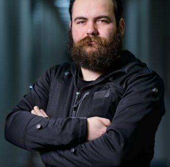 Victor Mateevitsi wearing the SpiderSense tactile jacket
