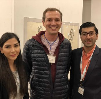 Students Sara Amini (left) and Mohammad Taha Khan (right), with Assistant Professor Chris Kanich (center).