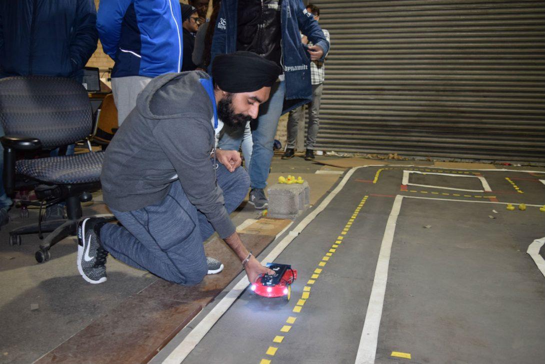 Engineering student Arshdeep Takkar places AV on roadway