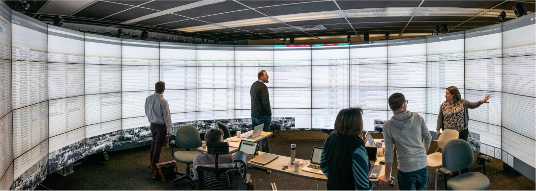 UIC's Liz Marai (center) and collaborators examine a large dataset in the Electronic Visualization Laboratory's high-resolution CAVE2 environment at the UIC College of Engineering. (Photo: UIC College of Engineering)
