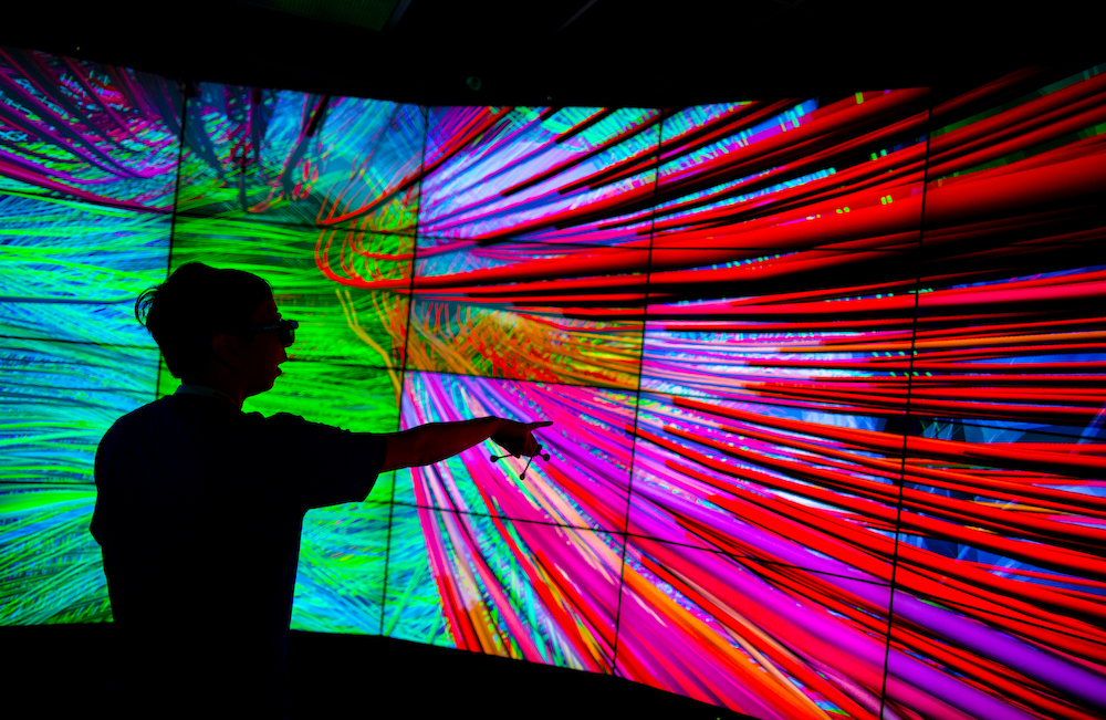 A student engages with a rainbow-colored visualization in the Electronic Visualization Lab