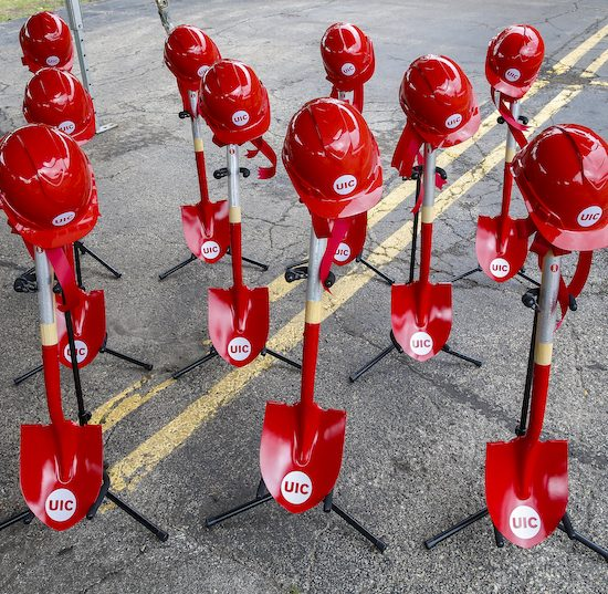 red ceremonial shovels and red UIC hard hats at the groundbreaking ceremony